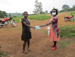 Tusiime Carolyne S.2 with her face masks.  (2)