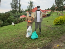 Kansiime Daphine's family with their food package (1)
