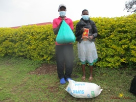 Kansiime Jackline's family with their food package (1)