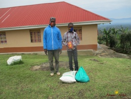 Mawenu Isaac's family with their food package (1)