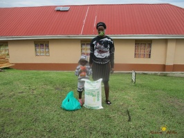 Mugenyi Robert's family with their food package (1)