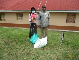 Mugisha Sharin's family with thier food package (1)