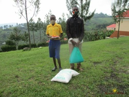 Kiiza Micheal's family with their food package (1)