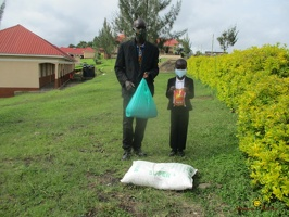 Mpairwe Alvin's family with their food package (1)